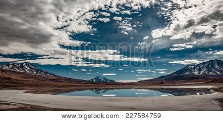 Lagoon On The Bolivian Altiplano, With Volcanoes All Around