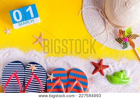 March 1st. Image Of March 1 Calendar With Summer Beach Accessories And Traveler Outfit On Background
