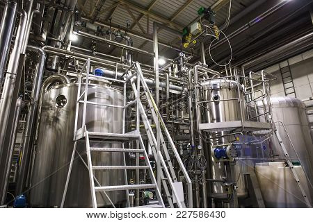 Industrial Factory, Steel Pipelines, Tubes At Brewery Production. Abstract Industrial Background, To