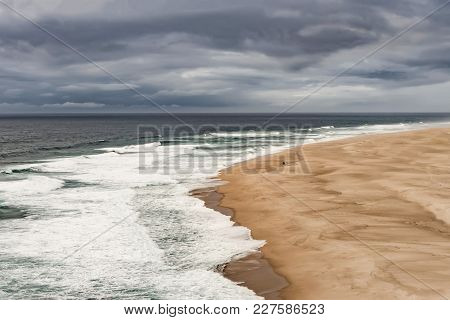 A Huge Beach Called Praia Do Norte, In Portugal, Seen From A Cliff