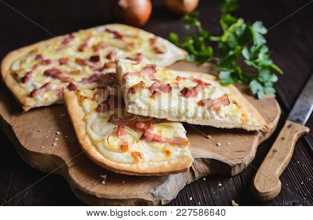 Traditional Tarte Flambée With Crème Fraiche, Cheese, Onion And Bacon
