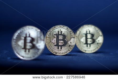 Three Coins Of Bitcoin On Black Background. Selective Focus. Information About Crypto Currency.