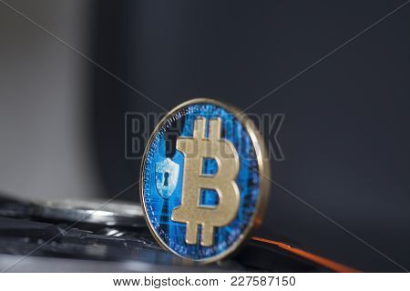 Blue Bitcoin Virtual Coin On A Black Background.