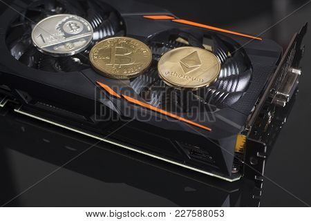 Cryptocurrency Mining Concept With Bitcoins And Ethereum On A Videocard On Black Background.