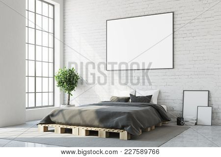 White Bedroom Corner With A Concrete Floor, A Master Bed And A Framed Horizontal Poster Above It. A
