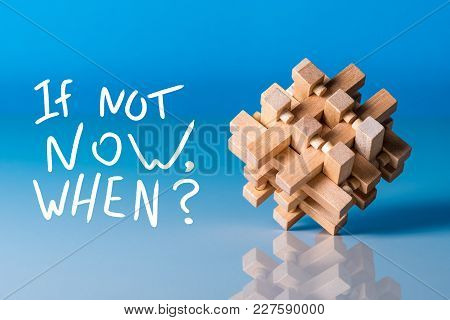 If Not Now, When - Question At Blue Background With Wooden Brain Teaser.
