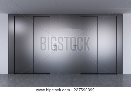 Elevator Hall In A Modern Office, Hospital Or A Hotel. Gray Wide Elevator Doors. Concept Of Modern B