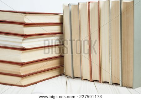 Pile Of Old Books Stacked On Top Of Each Other.