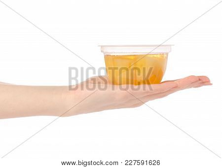 Cup Of Jelly With Fruit Yellow Pineapple In Hand On White Background Isolation Isolation