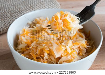 Fermented Cabbage And Carrots In A Bowl With A Fork