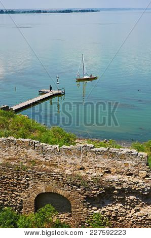Sailing Boat Near A Pier. View From Akkerman Fortress.
