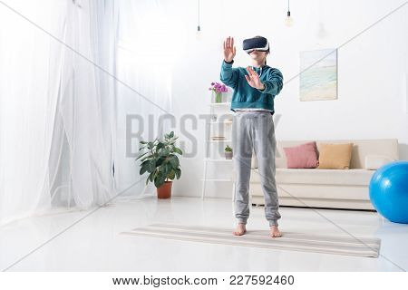Girl Touching Something With Virtual Reality Headset At Home
