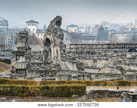 Aosta, Italy - Feb 17, 2018: Ruins Of Old Roman Theatre Built In The Late Reign Of Augustus, Some De