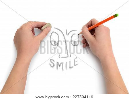 Hands Of An Artist Draw A Smile On White Paper
