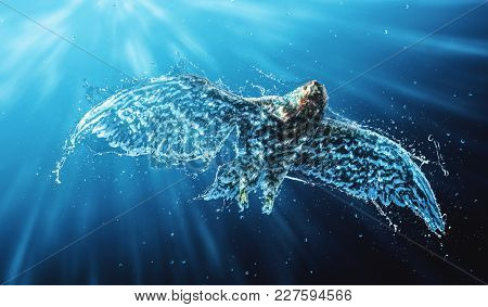 Flying eagle with underwater and splash effect of air bubbles on the feathers of its wings and light rays penetrating the blue background