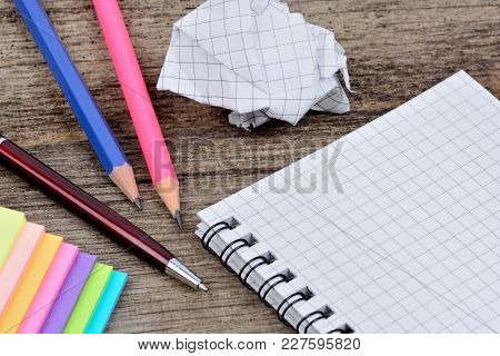 Empty Notepad With Pencils Anc Colorful Notes On Wooden Table