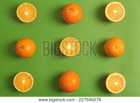 Juicy ripe oranges on color background
