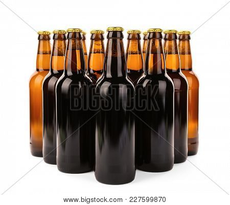 Glass bottles of beer isolated on white