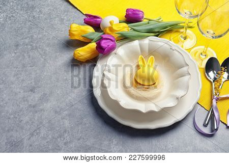 Beautiful festive Easter table setting on gray background