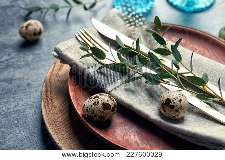 Beautiful festive Easter table setting with quail eggs, closeup