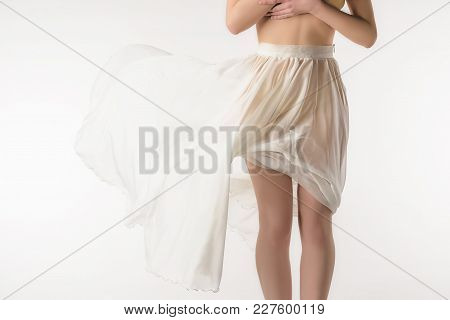 Cropped View Of Naked Girl In Transparent Skirt, Isolated On White