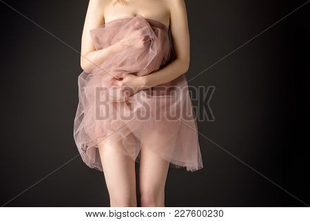 Partial View Of Sensual Girl Posing In Pink Chiffon Dress, Isolated On Grey