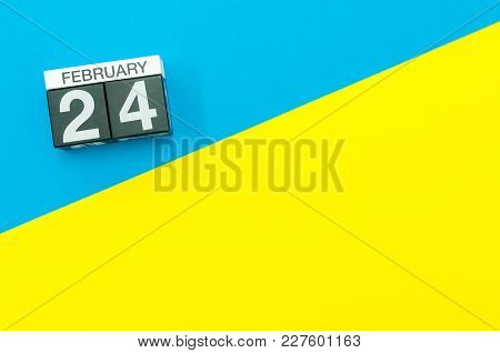 February 24th. Day 24 Of February Month, Calendar On Blue And Yellow Background Flat Lay, Top View.