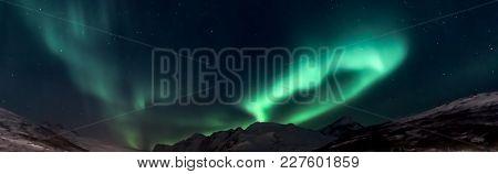 Aurora Borealis (northern Lights) Above Mountains Kaldfjord  - Kvaloya, North Norway