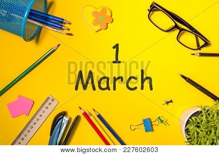 March 1st. Day 1 Of March Month, Calendar On Yellow Background With Office Supplies. Spring Time, To