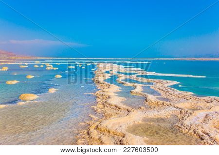 The concept of medical and ecological tourism. The evaporated salt. Reduced water in the very salty Dead Sea. Therapeutic Dead Sea, Israel