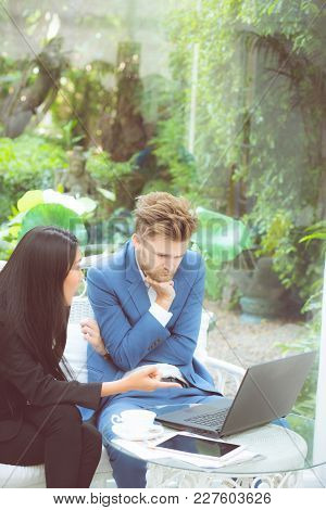 Technology And Office Concept - Two Business Man And Woman With Laptop - Tablet Pc Computer And Pape