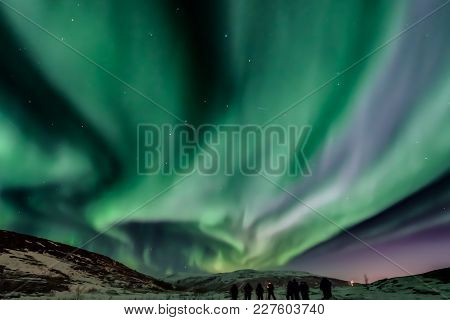 Aurora Borealis (northern Lights)  With Big Dipper Constellation In The Middle In North Norway And G