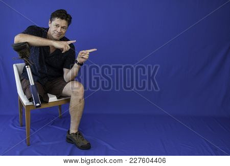 Middle-aged Man With Physical, Happy With Life And Pointing Two Options On The Screen
