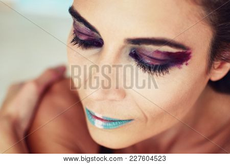 Portrait of the beautiful girl with creative art makeup with bright colors