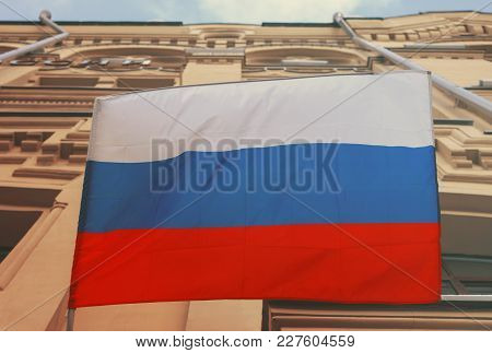 The National Flag Of The Russian Federation On The Wall Of The Building.