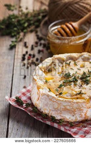 A Real Camembert From France With Thyme, Honey And Toasted Bread On Old Wooden Rustic Table. Soft Ch