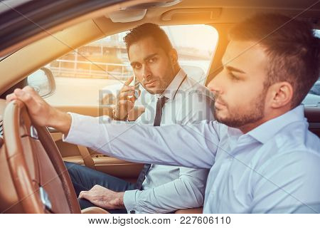 A Handsome Stylish Businessman And His Driver In A Car.