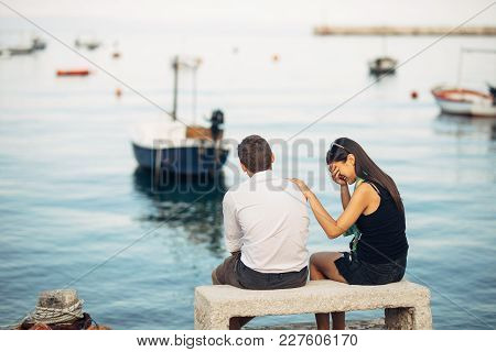 Romantic Couple Having Relationship Problems.woman Crying And Begging A Man.fisherman Life,dangerous