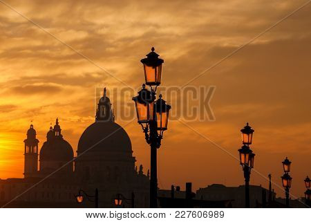 Venice Sunset With Old Domes, Lamp And Haze