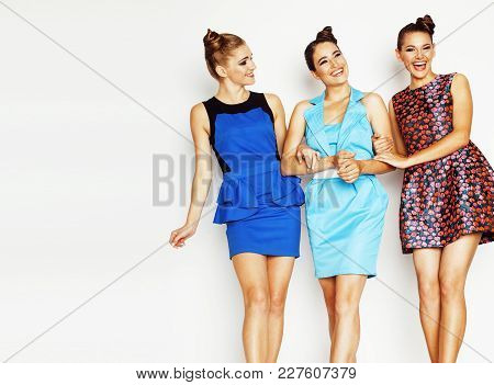 Group Of Diverse Stylish Ladies In Bright Dresses Isolated On White Smiling Having Fun, Watching Sel