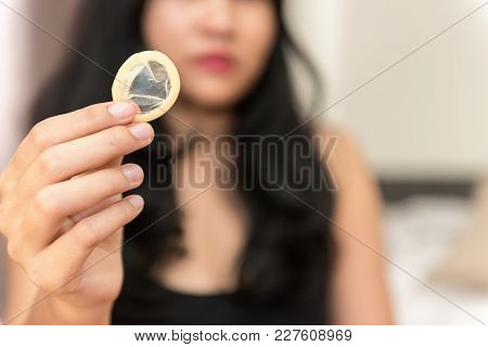 Asian Woman Holding Condom And Showing For Safe Sex In The Bed Room., Health And Medical Concept