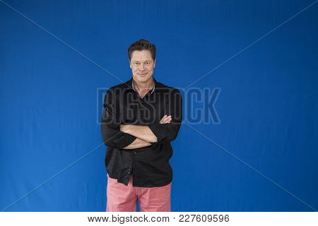 Man With Arms Crossed Looking At You