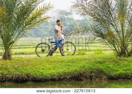 Chiang Mai Thailand - February 3 2018;  Rural Agricultural Worker Arrives At Rice Fields In Countrys