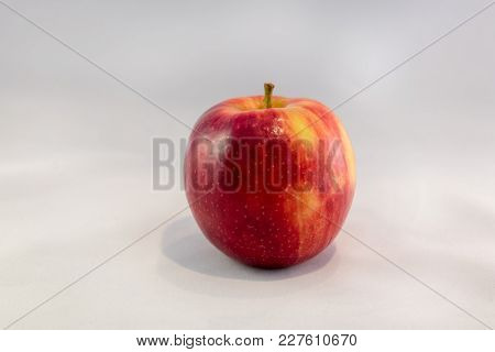 A Close-up Look Of A Jonagold Apple With A Neutral Background.