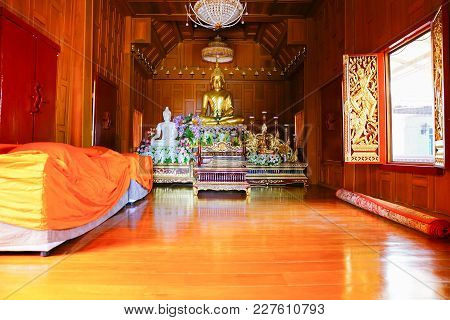 Inside Wooden Buddhist Temple With Large Golden Buddha With Polished Wooden Floors And Dark Timber P