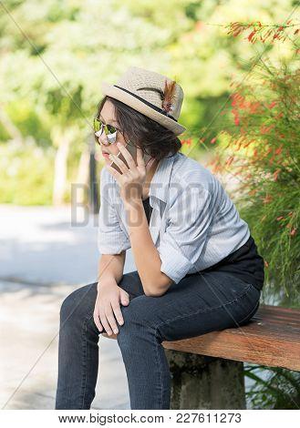 Women With Short Hair Wearing Hat In Garden