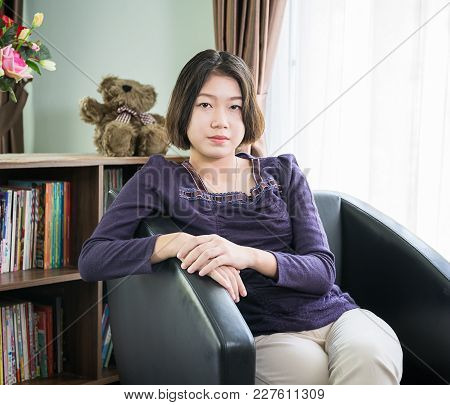 Close Up Beautiful Young Asian Woman Short Hair Listening Music In Living Room At Home