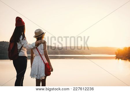 Happy Mother And Daughter Looking At The Sky During Sunset, Relax Time On Holiday Concept Travel,sel