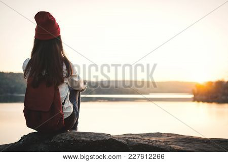 Happy Asian Woman Sitting On Rock In Nature During Sunset, Relax Time On Holiday Concept Travel,sele
