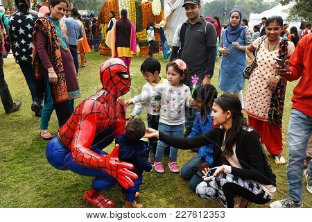 Chandigarh, India - Feb 19, 2017: Children Playing With A Statue Of Spiderman At Rose Festival In Za